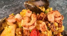 Paella with Chorizo, Shrimp, Calamari, Mussels, Green Peas, and Curry Butter JONATHAN DEARDEN
